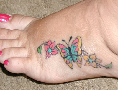 butterfly tattoo pictures. flower utterfly tattoo.