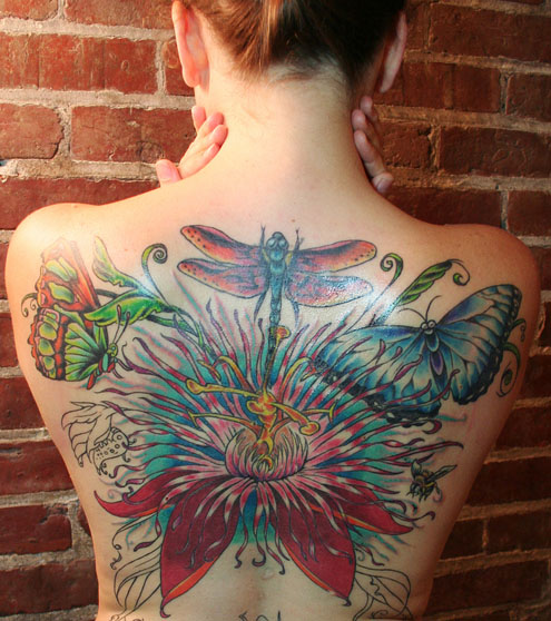 girl with sexy tattoo design butterfly full color on the back of the body