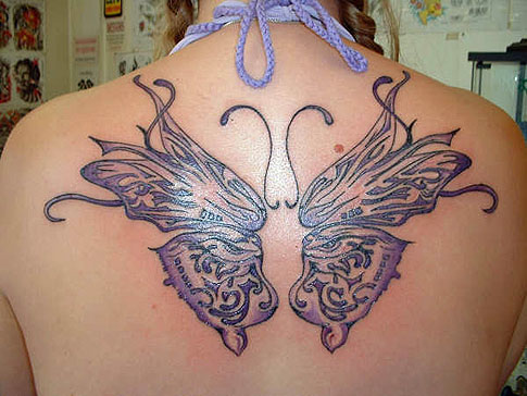 butterfly tattoo with purple on the back of the body of sexy girls
